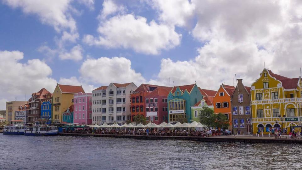 Colorful buildings line the inlet to the Santa Anna Bay.